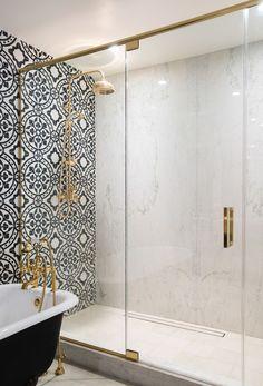 Spanish tiling in bathroom with black tub