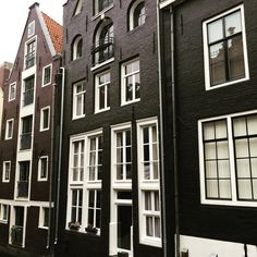 Love the charcoal and brown with crisp white windows