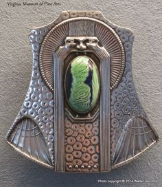 Virginia Museum of Fine Arts has a splendid collection.  The nickel and silver glass paste buckle, with its strange face and the wide open mouth, is something completely different.  It's about ten years later, 1909