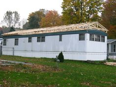 Home Renovation Exterior Build a roof over an existing mobile home roof - Protect Your Mobile Home From Water Leaks, Keep It Better Insulated And Improve The Overall Value Of Your Home With A Mobile Home Roof Over. Mobile Home Roof, Mobile Home Exteriors, Mobile Home Renovations, Mobile Home Repair, Mobile Home Makeovers, Mobile Home Living, Remodeling Mobile Homes, Home Remodeling, Bathroom Remodeling
