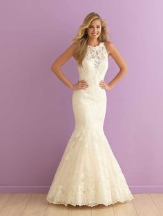 High-neck mermaid wedding dress with ivory lace blossoms covering the high neckline and illusion back by Allure Romance by @allurebridals