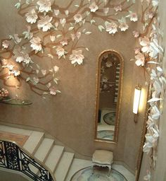 Exquisite paper flowers by paper artist Jo Lynn Alcorn adorned this staircase...magical!