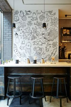 "Origin Coffee Roasters: ""Probably the trendiets coffee shop in Shoreditch"" - & certainly my fave - concrete floors, Ercol chairs, mural and awesome drinks."
