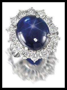 Star sapphire and diamond cluster ring. Via Diamonds in the Library.