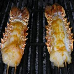 Orange zest and aromatic bitters lend an intriguing flavor to these grilled tails.