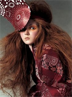 PAST: Alexander McQueen jacket and hat, from 2003. (Vogue, 2011) Lilly Cole