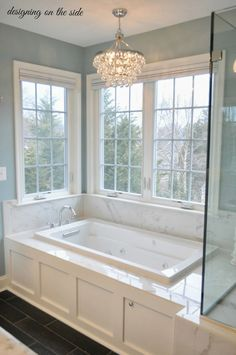 Soaking tub in front of big windows -- Plaster & Disaster