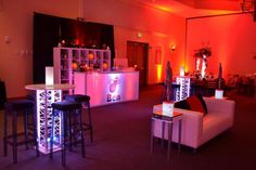 Miami Heat Basketball Themed Bar Mitzvah - LED Glowing Teen Lounge Area - Floral Arrangements for Adults - Red & Black Color Scheme - Party Perfect Boca Raton, FL 561-994-8833