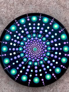 "Beatiful round stone 3"" inches in diameter painted with pink, green and purple original mandala dot art design. The design is hand painted using high quality acrylic paints then sealed multiple times with a premium high gloss finish."