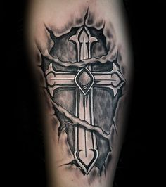 Stunning Classy Arm Tattoo Design Ideas For Men That Looks . Stunning Classy Arm Tattoo Design Ideas For Men That Looks Cool Tribal Cross Tattoos, Celtic Cross Tattoos, Cross Tattoo For Men, Cross Tattoo Designs, Tattoo Designs Men, Cross Designs, Ripped Skin Tattoo, Leg Tattoo Men, Leg Tattoos