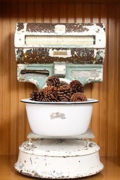 I have a few big old scales like this.  Good idea to put something decorative on them.