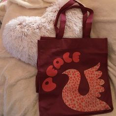 """FINAL SALE Reusable Grocery Bag from Forever21 Reusable """"Peace"""" Grocery Bag from Forever 21 in Burgundy. Has graphic on both sides. Includes thin cardboard base. Folds for easy storage. Used a couple times; slight cracking in certain areas on graphics. THIS IS THE FINAL SALE PRICE FOR THIS ITEM! Forever 21 Bags Totes"""