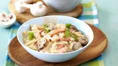 This delicious pasta dish is made using mushrooms and prawns.