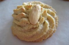 Amygdalota - Greek Almond Cookies Georgalis-Hertzberg is this the cookie from your shower? My mouth is salivating just looking at it lol Greek Sweets, Greek Desserts, Just Desserts, Greek Cake, Eat Greek, Greek Cookies, Almond Meal Cookies, Shortbread Cookies, Pastry Recipes