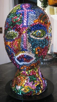 A Styrofoam bust, sequins and 4500 plus pins.