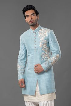 Powder Blue Raw Silk Sherwani Resham and Gold exquisite floral embroidery Handwoven, textured Cotton Silk, Ivory Chanderi Kurta Hand-crafted, Ivory Chikankari Salwar This is a three-piece look. Mens Indian Wear, Mens Ethnic Wear, Indian Groom Wear, Indian Men Fashion, Men's Fashion, Fashion Tips, Sherwani For Men Wedding, Wedding Dress Men, Wedding Suits