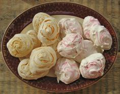 Colourful swirled meringues flavoured with orange and raspberry http://theproofofthepudding.net/2014/03/10/raspberry-and-orange-chocolate-dipped-meringues/