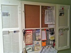 I saw the shutters as organizers first on Martha Stewart.  I added the center for more space for calendars, etc.  Top of center is a rollout pegboard material, the bottom is more of my hubby's metal handiwork. Also added hooks around center border.  Family central!