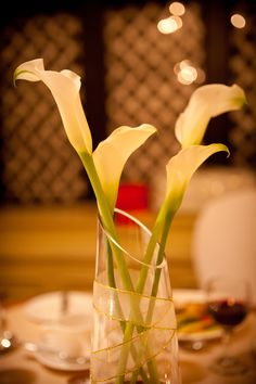 Cala lily by candle light as centerpiece at reception.