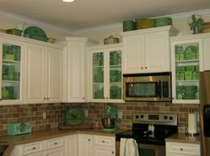 look at the glass cabinets with the fire king dishes!!! LOVE