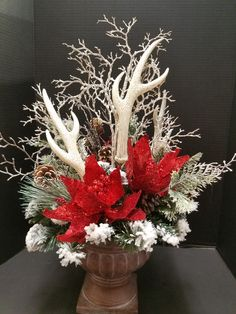 A beautiful centerpiece with deer horn and red poinsettia. Designed by Mary Bui for Michael store in Mission Viejo, Ca Christmas centerpiece 201u