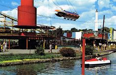 A 1960s postcard view of Dorney Park showing the rockets and the Journey to the Center of the Earth rides, along with the Water Scooters on the Cedar Creek.