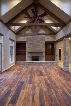 I love the big open concept and the stone pillars on one side!!