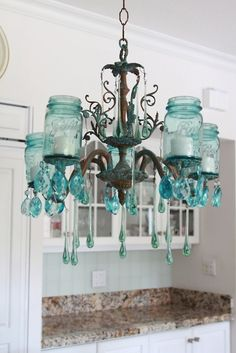 aqua blue masson jar chandelier. Now this is a really original use for mason jars!