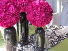Centerpieces I'd use for the reception-fuchsia hydrangea balls with black vases on a damask print runner and sage green table cloth or