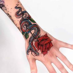 arm tattoo snake rose