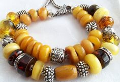 Amber Heaven!  This is the kind of beauty you see on our Forum! 22,000 photos of pure inspiration. http://trollbeadsgalleryforum.ning.com/