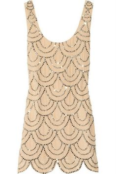 Love the scalloped design on this dress -- it looks like scales