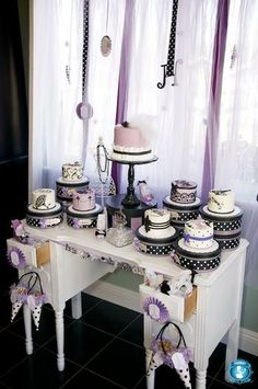 cake table...one bigger little one...maybe 2 tiers for the bride and groom to cut (save the top portion and  freeze to have on anniversary) then cupcakes for guests..?