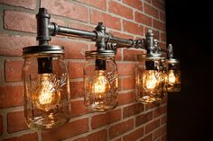 A handmade industrial chic four light fixture that is sure to add a truly charming accent to any home. This unique and re-imagined blend of metal pipe fittings and mason jars create a unique light that will surely add a warm and welcome atmosphere to your home or business. Features a quart size Bal