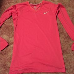 Nike long sleeve dri-fit Long sleeve bright pink with grey Nike dri-fit. Worn a few times great condition no stains or holes smoke free home. Nike Tops Tees - Long Sleeve