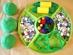 Make green play dough with mint and glitter. Then use it to make and decorate play dough Christmas trees.