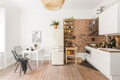 Studio apartment with round bed kitchen space