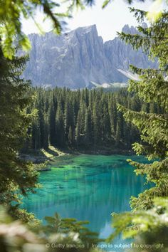 Italy, Dolomites, Latemar, Karersee, View of lake with mountain range in background