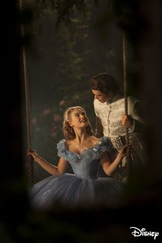 Cinderella (Ella) Prince Kit (Prince Charming) by the swing in the royal gardens