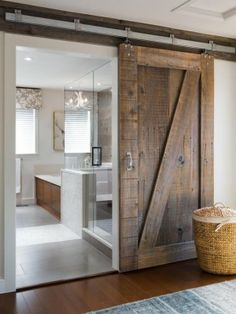 Sliding door, reclaimed wood, modern bathroom.
