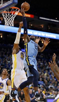 Memphis Grizzlies' Tyreke Evans (12) takes a shot against Golden State Warriors' David West (3) in the fourth quarter at Oracle Arena in Oakland, Calif., on Wednesday, Dec. 20, 2017. (Nhat V. Meyer/Bay Area News Group)