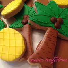 Hawaii/Island-themed cookies Coconut tree, pineapple, coconut cookies  Royal icing sugar cookies By Kathleen at curious confections in NJ Instagram: curious.confections