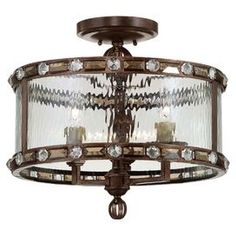 "Bring a touch of rustic French country inspiration to your foyer or dining room with this candelabra-inspired semi-flush mount, featuring rivet details and a banded iron design.    Product: Semi-flush mount Construction Material: Metal, crystal and glass Color: Gilded bronze Features: UL listed for dry locations Accommodates: (3) 60 Watt bulbs - not included Dimensions: 16"" H x 16.75"" Diameter"