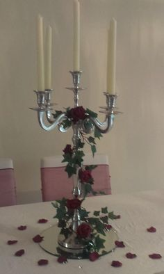 silver candelabra with ivy and burgundy rose garland