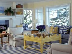 my favorite beach house picture ever now add two charlotte and ivy yellow chippendale chairs my blue and white hex garden stools the console you know beach house living room tropical family room