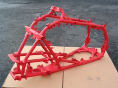 Powder coated motorcycle frame in gloss red. See our gallery here: http://boneheadperformance.com/photo-gallery/