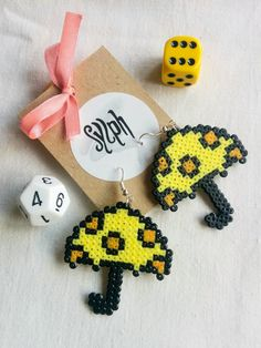 Quirky yellow and orange pixelart Hmmbrella earrings made of Hama Perler beads with white polkadots, an umbrella to brighten up wet days! Mini Hama Beads, Perler Beads, Perler Earrings, Perler Bead Art, Fuse Beads, Etsy Earrings, Seed Bead Crafts, Beaded Crafts, Pearler Bead Patterns