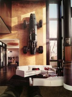 Why not have a race car as wall art. Love the look of that room.   Random Inspiration 99 | Architecture, Cars, Girls, Style & Gear