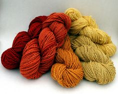 Naturally dyed wool yarn L to R-Eucalyptus(2), onion, virginia creeper, onion(2)