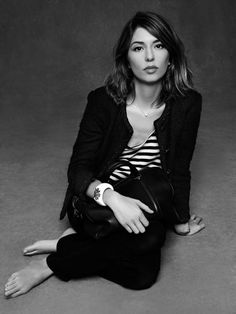 Sofia Coppola. Chanel Jacket. Louis Vuitton handbag.